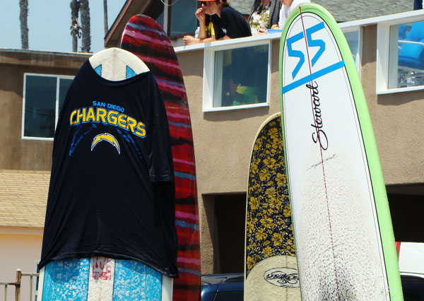 Surfboards for the paddle out are decorated in Charger wear, representing the past player.