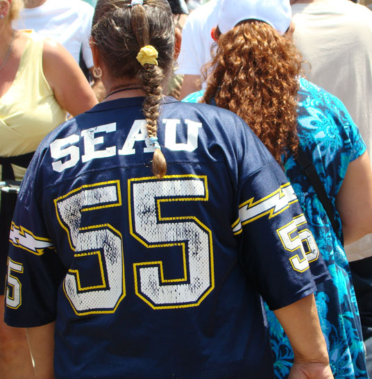 People sport the Junior Seau jerseys in honor of the lost hero.