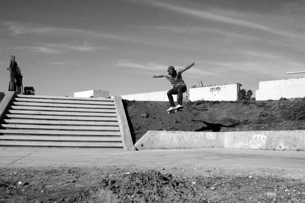 After reaching the peak of the jump, Markovich lands an ollie. 
