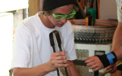 Shane Nowak heats it up as a glass blower